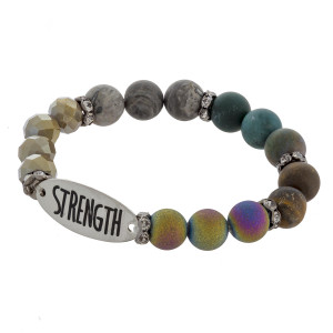 """Beaded stretch bracelet featuring """"Strength"""" inspiring message. Approximate 2.75"""" in diameter unstretched. Fits up to 5"""" wrist."""
