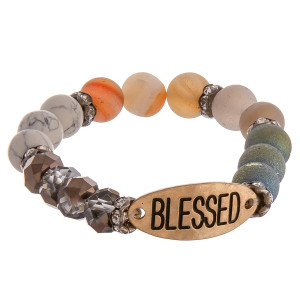 "Natural stone and faceted beaded stretch bracelet featuring ""Blessed"" engraved focal with rhinestone details. Approximately 2.75"" in diameter unstretched. Fits up to a 6"" wrist."