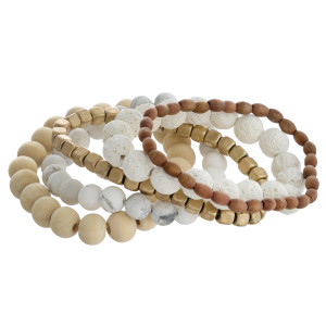 """Bracelet set featuring five stretch bracelets with wood, natural stone and lava rock inspired beads and gold accents. Approximately 2.5"""" in diameter unstretched. Fits up to a 5"""" wrist."""