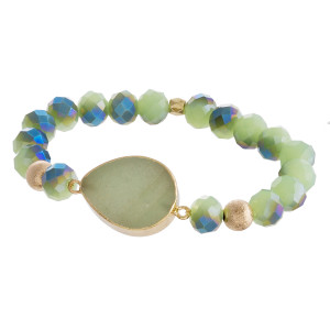 """Beaded stretch bracelet featuring a natural stone inspired focal with faceted bead details and gold accents. Approximately 3"""" in diameter unstretched. Fits up to a 6"""" wrist."""