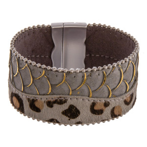 "Faux leather bracelet featuring animal print and scale details with a magnetic closure. Approximately 2"" in diameter unstretched. Fits up to a 5"" wrist."
