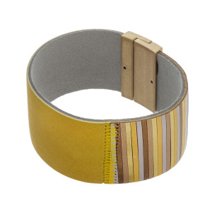 "Faux leather bracelet featuring a magnetic closure. Approximately 2.5"" in diameter. Fits up to a 5"" wrist."
