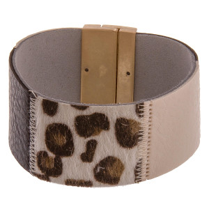 "Multi-colored leather cuff bracelets featuring animal print accents and a magnetic closure. Approximately 8"" in length. Fits up to a 4.5"" wrist."