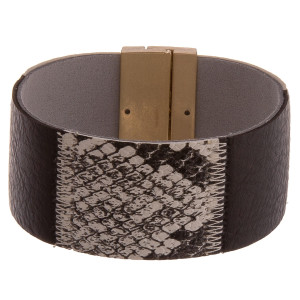 "Leather cuff bracelet featuring animal print accents and a magnetic closure. Approximately 8"" in length. Fits up to a 4.5"" wrist."