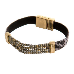 """Faux leather bracelet featuring a stretchy beaded focal with a magnetic closure. Approximately 3"""" in diameter. Fits up to a 6"""" wrist."""