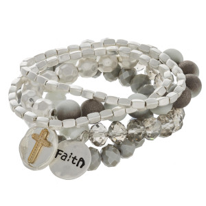 "Semi precious beaded charm bracelet set with ""Faith"" engraved details. Approximately 3"" in diameter unstretched. Fits up to a 6"" wrist."