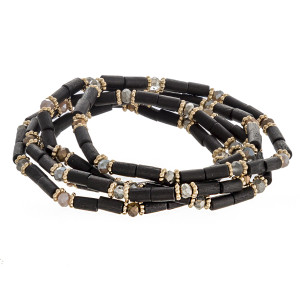 """Wood beaded stretch bracelet set featuring faceted bead details with gold accents. Approximately 3"""" in diameter unstretched. Fits up to a 6"""" wrist."""