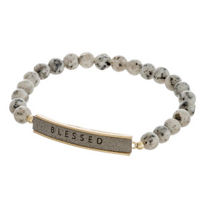 "Natural stone beaded stretch bracelet featuring a faux leather focal with ""Blessed"" engraved details. Approximately 3"" in diameter unstretched. Fits up to a 6"" wrist."