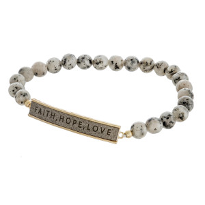 "Natural stone beaded stretch bracelet featuring a faux leather focal with ""Faith, Hope, Love"" engraved details. Approximately 3"" in diameter unstretched. Fits up to a 6"" wrist."