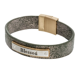 "Metallic faux leather bracelet featuring a metal focal with ""Blessed"" engraved details and a magnetic closure. Approximately 3"" in diameter. Fits up to a 6"" wrist."