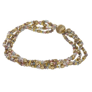 """Multi strand seed beaded bracelet featuring a magnetic closure. Approximately 3"""" in diameter. Fits up to a 6"""" wrist."""
