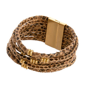 """Multi strand faux leather snakeskin bracelet featuring gold accents and a magnetic closure. Approximately 3"""" in diameter. Fits up to a 6"""" wrist."""