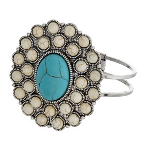 """Western style hinged bangle bracelet featuring a natural stone focal. Approximately 3"""" in diameter. Fits up to a 6"""" wrist."""