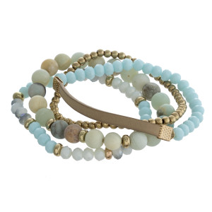 """Semi precious beaded stretch bracelet set featuring a faux leather strand detail. Approximately 3"""" in diameter unstretched. Fits up to a 6"""" wrist."""