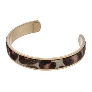 "Faux fur leopard print encased cuff bracelet. Approximately 2.5"" in diameter. Fits up to a 5"" wrist."