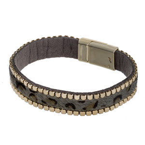 """Faux leather fur leopard print magnetic bracelet with gold stud accents. Approximately 3"""" in diameter. Fits up to a 6"""" wrist."""