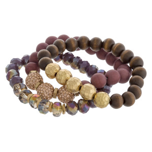 """Natural stone wood beaded rhinestone accented stretch bracelet set. Approximately 3"""" in diameter unstretched. Fits up to a 6"""" wrist."""