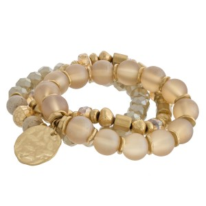 """Statement semi precious beaded stretch bracelet set of three featuring gold metal accents. Approximately 3"""" in diameter unstretched. Fits up to a 6"""" wrist."""