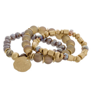 "Statement semi precious beaded stretch bracelet set of three featuring gold metal accents. Approximately 3"" in diameter unstretched. Fits up to a 6"" wrist."