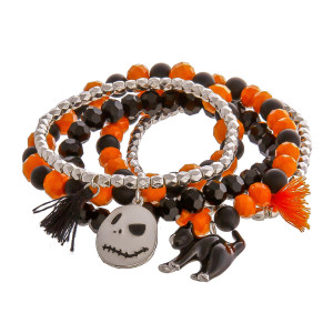 "Halloween ""Nightmare Before Christmas"" charm beaded stretch bracelet set with tassel accents. Approximately 3"" in diameter unstretched. Fits up to a 6"" wrist."