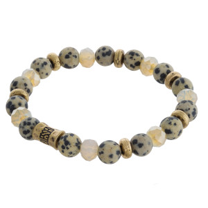 "Natural stone beaded stretch bracelet with ""Blessed"" engraved bead detail. Approximately 3"" in diameter unstretched. Fits up to a 6"" wrist."