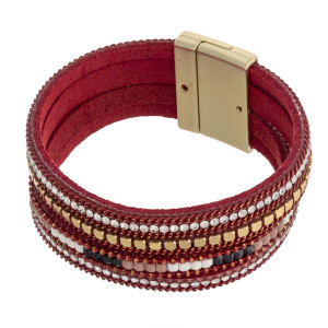 """Multi strand faux leather cubic zirconia beaded magnetic bracelet. Approximately 3"""" in diameter. Fits up to a 6"""" wrist."""