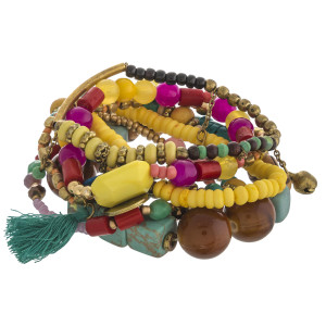 """Multicolor chunky beaded boho charm stretch bracelet set of seven featuring turquoise and tassel accents. Approximately 3"""" in diameter unstretched. Fits up to a 6"""" wrist."""