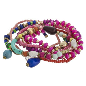 """Multicolor beaded boho charm stretch bracelet set of nine featuring gold accents. Approximately 3"""" in diameter unstretched. Fits up to a 6"""" wrist."""