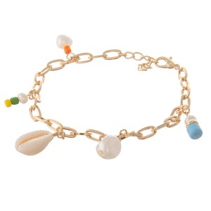 """Gold oval chain link charm anklet with shell and pearl details.  - Lobster clasp - Adjustable 1"""" extender - Approximately 4"""" in diameter - Fits up to a 10"""" ankle"""