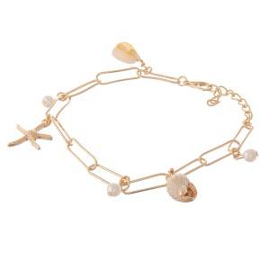 """Gold hera chain link seashell charm anklet.  - Lobster clasp - Adjustable 1"""" extender - Approximately 4"""" in diameter - Fits up to a 7"""" ankle"""