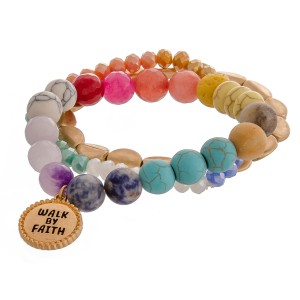 "Multicolor semi precious inspirational beaded stretch bracelet set of three featuring ""Walk by Faith"" engraved charm detail. Approximately 3"" in diameter unstretched. Fits up to a 6"" wrist."