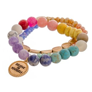 "Multicolor semi precious inspirational beaded stretch bracelet set of three featuring ""Believe in Yourself"" engraved charm detail. Approximately 3"" in diameter unstretched. Fits up to a 6"" wrist."
