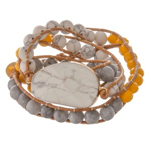 """Semi precious beaded natural stone cord wrap bracelet.  - Pull through button clasp - Adjustable 2"""" extender - Approximately 3"""" in diameter - Fits up to a 7"""" wrist"""