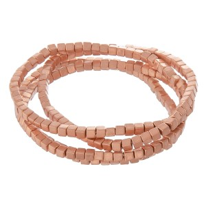 """Metal tone block beaded stretch bracelet set.  - 4pcs/pack - Approximately 3"""" in diameter unstretched - Fits up to a 7"""" wrist"""