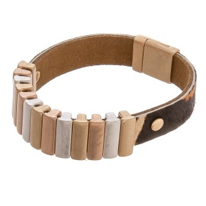"""Cowhide animal print bar magnetic bracelet.  - Magnetic closure - Approximately 3"""" in diameter - Fits up to a 6"""" wrist"""