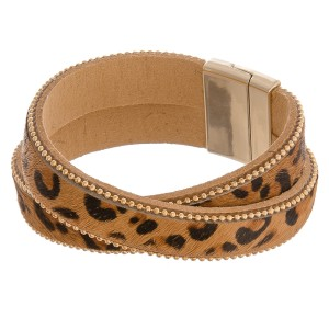 """Faux leather criss-cross leopard print magnetic bracelet.  - Magnetic closure - Approximately 3"""" in diameter - Fits up to a 6"""" wrist"""