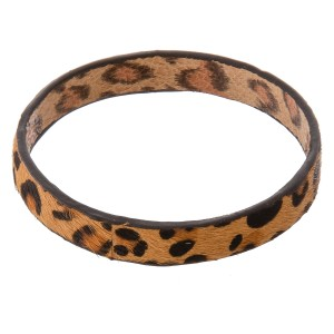 """Genuine leather double sided leopard print cowhide bangle bracelet.  - Approximately 3"""" in diameter - Fits up to a 6"""" wrist"""