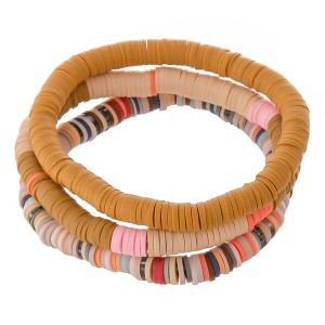 """Polymer Clay spacer disc beaded stretch bracelet set.  - 3pcs/set - Approximately 3"""" in diameter - Fits up to a 7"""" wrist"""