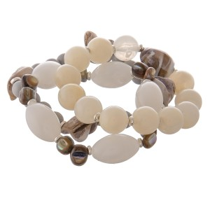 """Semi precious beaded ivory shell bracelet set of three.  - Approximately 3"""" in diameter unstretched - Fits up to a 7"""" wrist"""