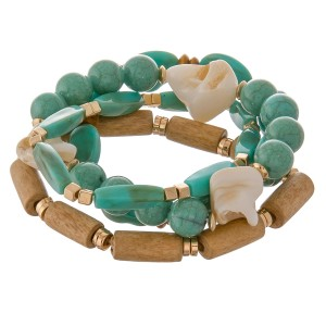 """Semi precious beaded shell bracelet set of five with wood details.  - Approximately 3"""" in diameter unstretched - Fits up to a 7"""" wrist"""