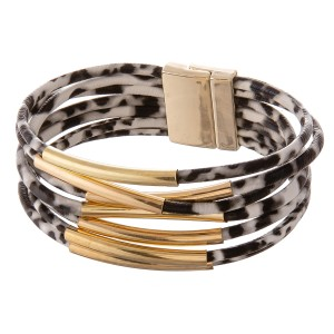 """Faux leather multi strand leopard print magnetic closure with gold accents.  - Magnetic closure - Approximately 3"""" in diameter - Fits up to a 6"""" wrist"""