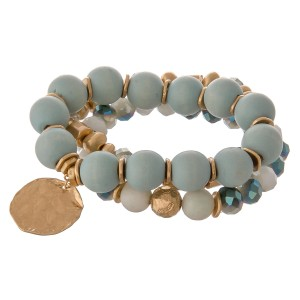 """Semi precious wood beaded statement charm stretch bracelet.  - 3pcs/pack - Charm approximately 1"""" in diameter  - Approximately 3"""" in diameter unstretched - Fits up to a 7"""" wrist"""