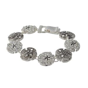 "7 1/2"" around silver tone bracelet featuring sand-dollars with rhinestone details."