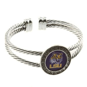 Officially licensed silver toned cuff bracelet with crystal rhinestones surrounding the Louisiana State University logo.