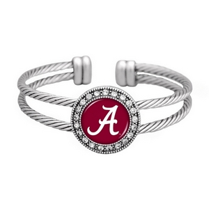 Officially licensed silver toned cuff bracelet with crystal rhinestones surrounding the Alabama logo.