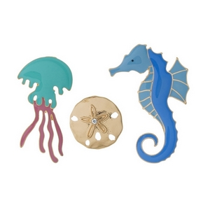 Three piece pin set featuring a sand dollar, jellyfish, and seahorse.