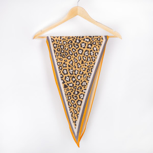"""Leopard with yellow  border neckerchief. 100% polyester. Approximate 28x28"""" in length."""