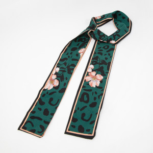"""Green leopard with floral neck scarf. 100% polyester. Approximate 46"""" in length."""