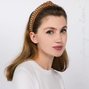 Do everything in Love brand knotted plaid headband.  - One size fits most adults - 100% Polyester
