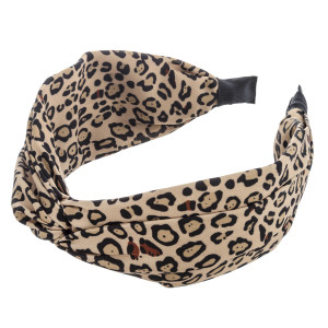 Wide leopard print knotted headband.  - One size fits most  - 100% Polyester